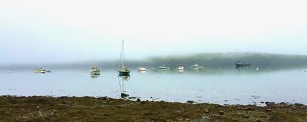 Foggy Morning -- Anchored boats reflect in the still water of Eastern Bay near Lamoines State Park in Maine