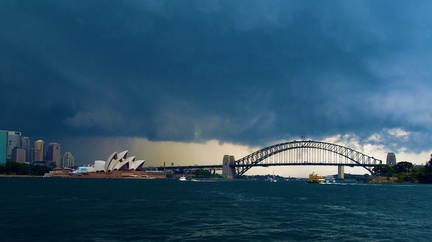 Storm Over Circular Quay -- A storm brews over the city of Sydney behind the famous Circular Quay. This picture features the Opera House and Harbour Bridge in the foreground.