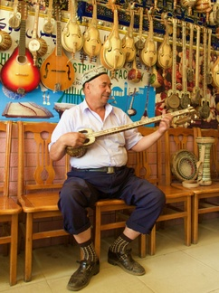 Music Store, Kashgar Market -- This gentlemen entertained us with masterfully played folk tunes. The instrument is a seven-stringed tanbur, a sort of Turkish banjo.